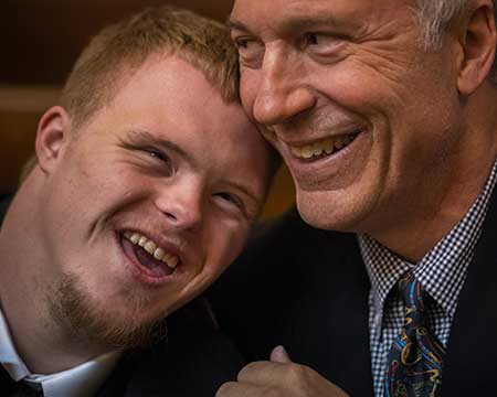 father with happy disabled adult son