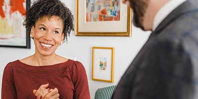 African American woman talking to an attorney