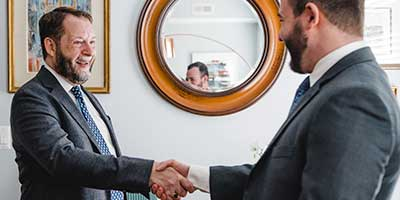 Thomas B. Stahl shaking hands with a male client