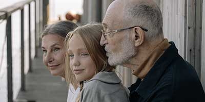 grandparents with their grand daughter