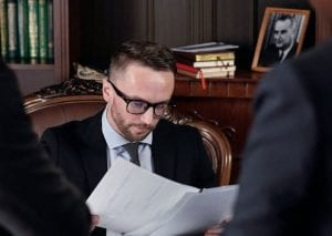 caucasian man in his office reviewing a document